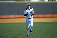 Brian Moskey (7) of the Quinnipiac Bobcats jogs off the field between innings of the game against the Radford Highlanders at David F. Couch Ballpark on March 4, 2017 in Winston-Salem, North Carolina. The Highlanders defeated the Bobcats 4-0. (Brian Westerholt/Four Seam Images)