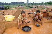 Ouro Verde Garimpo, Para State, Brazil. Two young boys panning for gold.