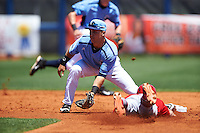 Charlotte Stone Crabs second baseman Jace Conrad (19) waits for a throw as Mikey Reynolds (4) slides into second during a game against the Palm Beach Cardinals on April 10, 2016 at Charlotte Sports Park in Port Charlotte, Florida.  Palm Beach defeated Charlotte 4-1.  (Mike Janes/Four Seam Images)