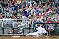 TCU Horned Frogs third baseman Derek Odell (5) leaps to catch a ball as Vanderbilt Commodores baserunner Jeren Kendall (3) slides into third during Game 12 of the NCAA College World Series on June 19, 2015 at TD Ameritrade Park in Omaha, Nebraska. The Commodores defeated TCU 7-1. (Andrew Woolley/Four Seam Images)
