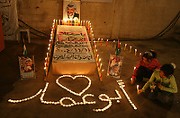 "Palestinian girls take part in a candle-lit rally, organised by the recently formed group Fatah al-Yasser (Yasser's Fatah), at the home of late leader Yasser Arafat in Gaza city, 11 November 2007, to mark the anniversary of his death. Palestinian president Mahmud Abbas today hailed an ""historic opportunity"" for peace as his people marked the third anniversary of the death of his iconic predecessor Yasser Arafat. photo by Fady Adwan"""