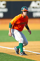 Shane Rowland #24 of the Miami Hurricanes takes his lead off of third base against the Wake Forest Demon Deacons at Gene Hooks Field on March 19, 2011 in Winston-Salem, North Carolina.  Photo by Brian Westerholt / Four Seam Images