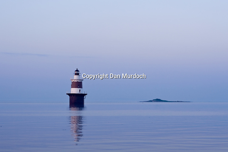 Lighthouse on blue cast moring