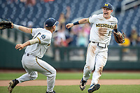 Michigan Wolverines first baseman Jimmy Kerr (15) and third baseman Riley Bertram (12) celebrate defeating the Texas Tech Red Raiders in the NCAA College World Series on June 21, 2019 at TD Ameritrade Park in Omaha, Nebraska. Michigan defeated Texas Tech 15-3 and will play in the CWS Finals. (Andrew Woolley/Four Seam Images)