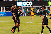 Mexico midfielder Fernando Arce (16) celebrates a goal. Mexico defeated the Ivory Coast 4-1 during an international friendly at MetLife Stadium in East Rutherford, NJ, on August 14, 2013.