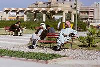Kuwait January 1967.  Arab Men in Kuwait, one of African Origin, Resting in a Park.