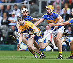 Tony Kelly of Clare in action against Brendan Maher and Padraig Maher of Tipperary during their quarter final at Pairc Ui Chaoimh. Photograph by John Kelly.