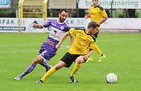 Sporting West Harelbeke - SCT Menen :<br /> Dieter Meulenyzer (R) draait weg bij Jessy Lebsir (L)<br /> <br /> Foto VDB / Bart Vandenbroucke