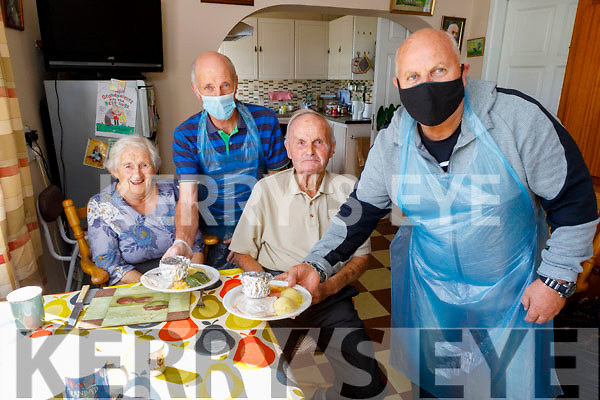 Maureen and Frank O'Donoghue in Garrynagore, Kilflynn having their meal delivered by Buds Meals on Wheels of Ballyduff on Monday by Donal Pierce and Anthony O'Carroll.. L to r: Maureen O'Donoghue, Donal Pierce, Frank O'Donoghue and Anthony O'Carroll.
