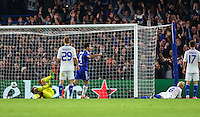 Aleksandar Dragovic of Dynamo Kyiv lays on the ground (2nd right) as he scores an own goal to make it 1-0 during the UEFA Champions League Group match between Chelsea and Dynamo Kyiv at Stamford Bridge, London, England on 4 November 2015. Photo by David Horn.