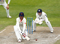 28th May 2021; Emirates Old Trafford, Manchester, Lancashire, England; County Championship Cricket, Lancashire versus Yorkshire, Day 2; Keaton Jennings of Lancashire plays a reverse sweep shot as Yorkshire keeper Harry Duke watches closely