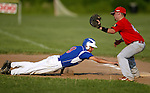 WOLCOTT, CT, 06 JULY 2011-070611JS05--Torrington's Ted Gravel (9) dives back safely to first base as Wolcott's Mike Gigliotti (4) covers the play during American Legion action Wednesday at Wolcott High School.<br /> Jim Shannon/Republican-American