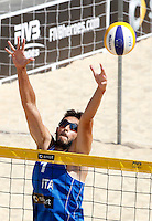 Italy's Paolo Nicolai in action during the match between Italy and Austria at the Beach Volleyball World Tour Grand Slam, Foro Italico, Rome, 21 June 2013.<br />