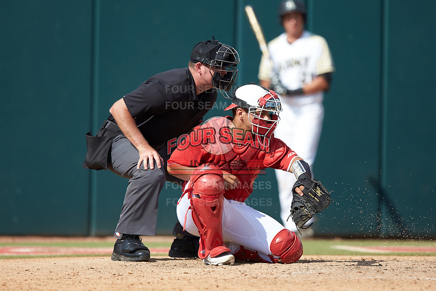 North Carolina State Wolfpack catcher Jack Conley (23) on defense as home plate umpire Mike Jarboe looks on during the game against the Army Black Knights at Doak Field at Dail Park on June 3, 2018 in Raleigh, North Carolina. The Wolfpack defeated the Black Knights 11-1. (Brian Westerholt/Four Seam Images)