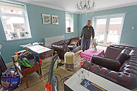 Pictured: Stefan Morgan in his flood affected living room in Porth. Wednesday 04 March 2020<br /> Re: Revisiting the flood affected areas in Pontypridd, Wales, UK.