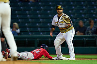 Rochester Red Wings first baseman Mike Ford (16) catches a pickoff throw as Grant Williams (22) dives back to the bag during a game against the Worcester Red Sox on September 2, 2021 at Frontier Field in Rochester, New York.  (Mike Janes/Four Seam Images)