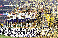 LAS VEGAS, NV - AUGUST 1: Sebastian Lletget #17 of the United States lifts the Gold Cup trophy after a game between Mexico and USMNT at Allegiant Stadium on August 1, 2021 in Las Vegas, Nevada.