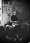 Ian MacKaye of Minor Threat eating lunch in his bedroom at Dischord House, Arlington VA, spring 1982.