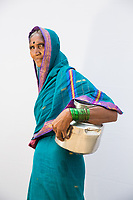 Hirakbai Vardul, 60, collects 12 pots of water everyday from government tankers which deliver water to the village of Sayyad Ankulga near the drought-hit city of Latur.