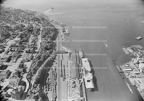 0103-A051 (Tacoma harbor and old town including clock tower and McMenamins Elks Lodge. USS Princeton CV-37 aircraft carrier. no date. This is probably the aircraft carrier coming out of the Reserve Fleet to go to the Korean War in the early 1950s.)