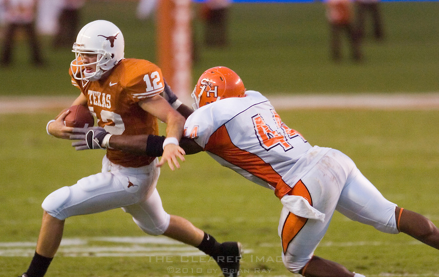 30 September 2006: Texas quarterback Colt McCoy (#12) breaks a tackle by Sam Houston State defender Patrick Robinson (#44) during the Longhorns 56-3 victory over the Sam Houston State Bearkats at Darrell K Royal Memorial Stadium in Austin, TX.