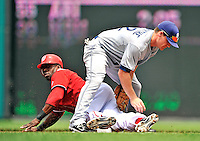 29 May 2011: Washington Nationals outfielder Roger Bernadina steals second sliding below San Diego Padres second baseman Logan Forsythe in the bottom of the first inning at Nationals Park in Washington, District of Columbia. The Padres defeated the Nationals 5-4 to take the rubber match of their 3-game series. Mandatory Credit: Ed Wolfstein Photo