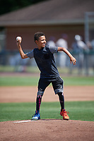 Young fan throws out the ceremonial first pitch before the second game of a doubleheader between the Mahoning Valley Scrappers and Auburn Doubledays on July 2, 2017 at Falcon Park in Auburn, New York.  Mahoning Valley defeated Auburn 3-2.  (Mike Janes/Four Seam Images)