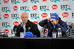 Uncle Mo owner Mike Repole switches from a Uncle Mo cap to his other Derby starter, Stay Thirsty cap, during the press conference to announce they will scratch one of Repole's Kentucky Derby starter Uncle Mo.