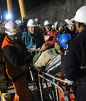 Rescue in San Jose mine, north of Chile, president Sebastian Piñera and bolivian miner just rescued Carlos Mamani