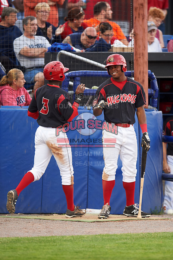 Batavia Muckdogs shortstop Anfernee Seymour (3) is congratulated by teammate Stone Garrett after scoring a run during a game against the Mahoning Valley Scrappers on July 3, 2015 at Dwyer Stadium in Batavia, New York.  Batavia defeated Mahoning Valley 7-4.  (Mike Janes/Four Seam Images)
