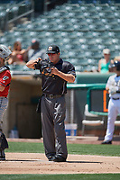 Umpire Ben May handles the calls behind the plate during the game between the Salt Lake Bees and the El Paso Chihuahuas at Smith's Ballpark on July 8, 2018 in Salt Lake City, Utah. El Paso defeated Salt Lake 15-6. (Stephen Smith/Four Seam Images)