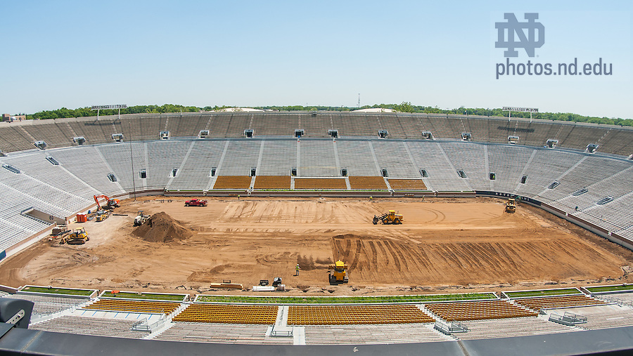 Transition from natural grass to field turf in Notre Dame Stadium, summer 2014.<br /> <br /> Photo by Matt Cashore/University of Notre Dame