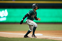 Nick Gonzales (2) of the Greensboro Grasshoppers takes his lead off of third base against the Winston-Salem Dash at Truist Stadium on August 13, 2021 in Winston-Salem, North Carolina. (Brian Westerholt/Four Seam Images)