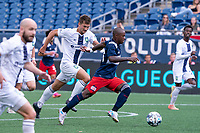 FOXBOROUGH, MA - JULY 4: Michel #48 of the New England Revolution II brings the ball forward during a game between Greenville Triumph SC and New England Revolution II at Gillette Stadium on July 4, 2021 in Foxborough, Massachusetts.