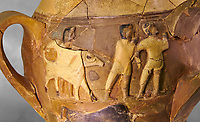 Hüseyindede vases, Old Hittite Polychrome Relief vessel, close up depicting a bull being led to be sacrificed, following Hittite convention of sacrificing an animal of the same gender as the God this bull indicates the sacrifice is to a male god, 16th century BC.. Çorum Archaeological Museum, Corum, Turkey. Against a grey bacground.