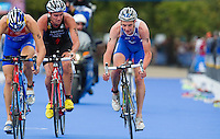 07 AUG 2011 - LONDON, GBR - Alistair Brownlee (GBR) (right) takes his own line through transition beside Alexander Bryukhankov (RUS) (left) and James Elvery (NZL) (centre) as the lead pack start another lap of the bike during the men's round of triathlon's ITU World Championship Series (PHOTO (C) NIGEL FARROW)