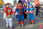 TORRINGTON CT. 31 October 2014-103114SV02-From left, Braiden Schrager, 3, Jeremiah Drumwright,3, and Trevor Rich, 3, all of Torrington go out trick or treating with the Brooker Memorial day care in Torrington Friday. Every year, children in the day care at Brooker Memorial get an early start to Halloween. Several of the non-profit's neighbors in the community decorate their homes or businesses and invite the children from the Brooker Memorial Early Learning and Child Care Center to come trick or treating. <br /> Steven Valenti Republican-American