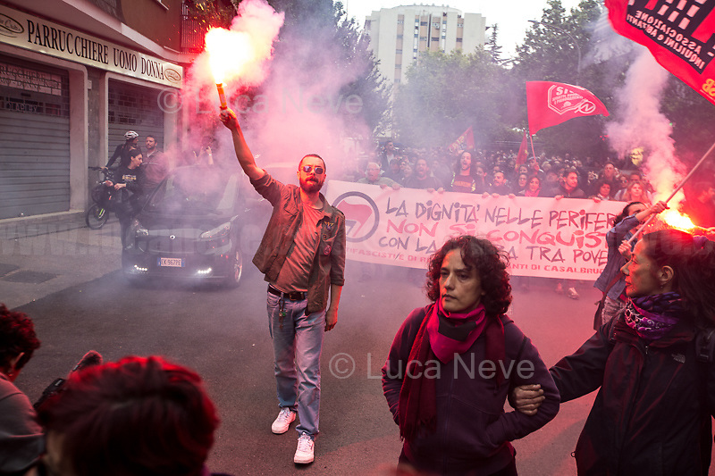 """Antifascists.<br /> <br /> Roma, 08/05/2019. Today, members of the far-right/neo-fascist political party 'casapound', held a rally in Casal Bruciato (suburb in the East side of Rome) in response to the allocation of a council flat to a Roma family - legally in the waiting list of Rome's Municipality - with twelve children and not any previous offenses committed. On the 7th of May a similar protest was held with the support of some residents of the district. Some members of the fascist organization 'casapound', undisputed by the police, insulted and menaced the Roma woman - while she was carrying her daughter in her arms - to """"rape"""" her, that she is a """"prostitute"""", and that all Roma people should be """"hanged"""".<br /> In the meantime, Anti-fascist / Anti-racist Organizations, Movements for Housing, social centres, members of the public, supported by trade unions and lefty political parties, held a counter-demonstration nearby. The demo was called to protest against the rally of """"casapound"""", accused to be a fascist group (illegal for the Italian Law so which needs to be immediately closed) - they call themselves """"fascists of the third millennium"""" - trying to fomenting hatred, pushing the people of the suburbs in a war between poor people, and to be just """"narrow-minded slander"""" ('sciacallaggio' in Italian).  <br /> The heavy police presence in full riot gears, supported by a water cannon truck and a helicopter, kept the two sides apart letting the Antifascist movements having a march in the district, once a historic """"Roccaforte Rossa"""" (a red stronghold)."""