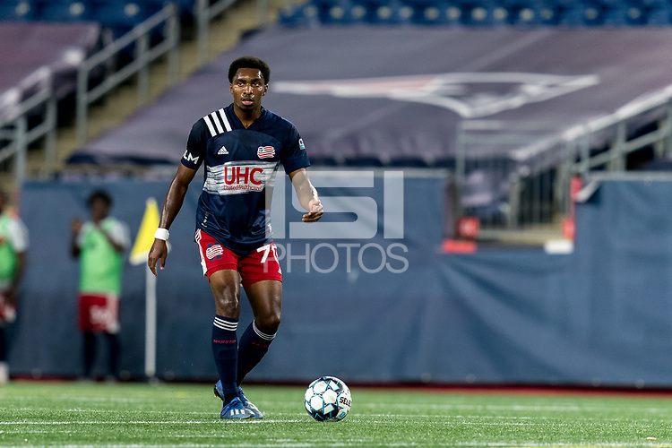 FOXBOROUGH, MA - SEPTEMBER 09: Jon Bell #70 of New England Revolution II looks to pass during a game between Chattanooga Red Wolves SC and New England Revolution II at Gillette Stadium on September 09, 2020 in Foxborough, Massachusetts.