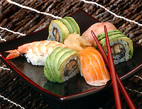 Sushi Variety on square Plate Nigirisushi; tuna, shrimp, avocado roll, salmon