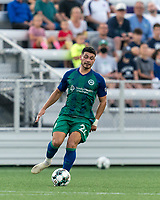HARTFORD, CT - AUGUST 17: Darwin Lom #24 of Hartford Athletic passes the ball during a game between Charleston Battery and Hartford Athletic at Dillon Stadium on August 17, 2021 in Hartford, Connecticut.