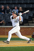 Matt Conway (25) of the Wake Forest Demon Deacons connects for the first of his two home runs on the night against the Maryland Terrapins at Wake Forest Baseball Park on April 4, 2014 in Winston-Salem, North Carolina.  The Demon Deacons defeated the Terrapins 6-4.  (Brian Westerholt/Four Seam Images)
