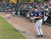 Kyle Kubitza (39), left, and Robby Hefflinger (36), right, of the Rome Braves pretend to play a ping pong game during a lengthy rain delay before a game against the Greenville Drive on July 5, 2012, at Fluor Field at the West End in Greenville, South Carolina. The game eventually was postponed due to rain. (Tom Priddy/Four Seam Images)