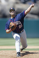 Eric Milton of the Minnesota Twins pitches during a 2002 MLB season game against the Los Angeles Angels at Angel Stadium, in Anaheim, California. (Larry Goren/Four Seam Images)