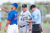 AZL White Sox manager Tommy Thompson (49) talks to AZL Cubs 2 manager Claudio Almonte (15) and home plate umpire Larry Dillman, Jr. before an Arizona League game against the AZL Cubs 2 at Sloan Park on July 13, 2018 in Mesa, Arizona. The AZL Cubs 2 defeated the AZL White Sox by a score of 6-4. (Zachary Lucy/Four Seam Images)