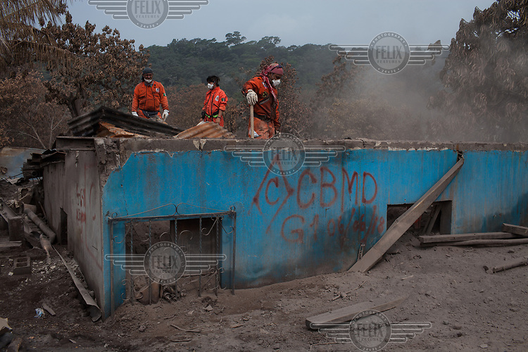 Members from the renowned Topos (Moles) Mexican rescue team attempt to recover human remains by entering from the roof of a home buried in volcanic debris spewed by Fuego Volcano completely destroyed the community on Sunday 3 June 2018. Mr. Ortiz is hoping to recover the remains of his son Jesus Ezequiel Ortiz and other relatives whose home was completely buried under the volcanic debris. As of now, over 110 victims have been identified, with at least 200 missing and thousands evacuated from neighboring villages.