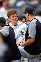 Staten Island Yankees Josh Breaux (28) talks with pitcher Matt Sauer (54) in the dugout during a game against the Lowell Spinners on August 22, 2018 at Richmond County Bank Ballpark in Staten Island, New York.  Staten Island defeated Lowell 10-4.  (Mike Janes/Four Seam Images)