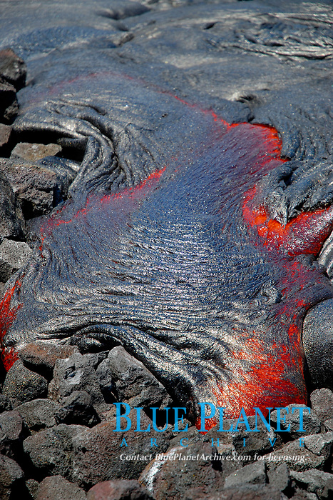 A large lava flow from Royal Gardens subdivision flows towards the Waikupanaha ocean entry on an old fishing access road, Kilauea volcano, east of Hawaii, USA, Pacific Ocean Volcanoes National Park, Big Island of Hawaii, USA, Pacific Ocean