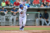 Tennessee Smokies center fielder Albert Almora Jr. (6) lays down a bunt during a game against the Mobile BayBears on May 27, 2015 in Kodak, Tennessee. The Smokies defeated the BayBears 3-2. (Tony Farlow/Four Seam Images)