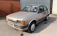 BNPS.co.uk (01202 558833)<br /> Pic: HampsonAuctions/BNPS<br /> <br /> Pictured: 1987 Ford Fiesta 1.1 L.<br /> <br /> Since the 1990s, Geoff Barlow, 46, has collected dozens of classic cars from an Escort Mexico replica to several types of Transit, Cortina, and Sierra.<br /> <br /> However, he still regrets selling the first car which inspired his passion, a 1980 Escort Mark 2 he bought from his sister in 1992.  <br /> <br /> Geoff's fascination with Fords gathered pace in the last decade and he 'lost control,' buying as many Fords as he came across and saving them from disrepair.